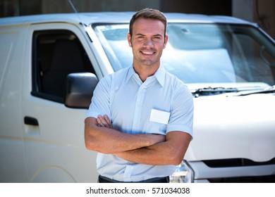 Portrait of handyman standing near his delivery van
