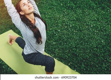 Portrait of happiness young woman practicing yoga on outdoors.Yoga and relax concept. Beautiful girl practice asana