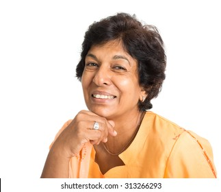 Portrait of a happy 50s Indian mature woman smiling, isolated on white background.