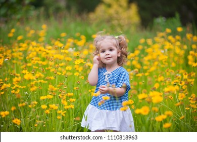Portrait of a happy adorable baby girl in the park