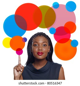 Portrait of a happy African American business woman pointing up with a smile on white background with thought bubble