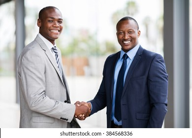 portrait of happy african american businesspeople handshaking