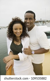Portrait of a happy African American couple enjoy sailing on the yacht