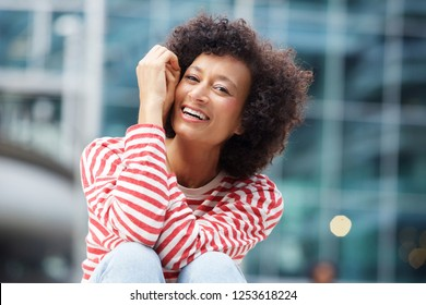 Portrait of happy african american woman laughing outdoors