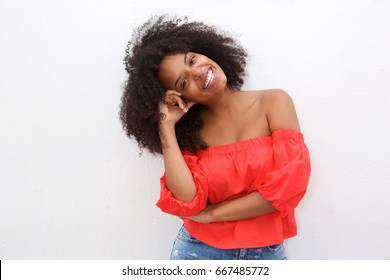 Portrait of happy african american woman leaning with head on hand