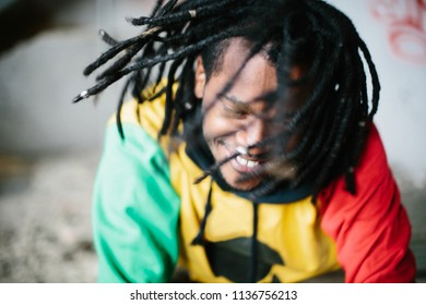 Portrait of happy African man with dreadlocks