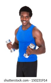 Portrait Of Happy African Man Exercising With Dumbbells Over White Background