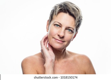 Portrait of happy aged woman isolated over white background. Studio shot