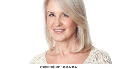 Portrait of happy aged woman over white background