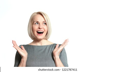 Portrait of happy aged woman. Surprised happy woman looking sideways in excitement Isolated.