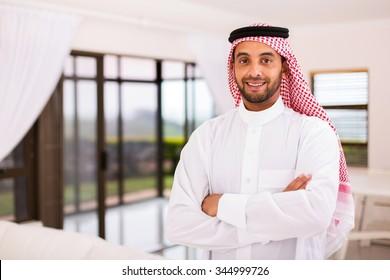 portrait of happy arabian man standing indoors