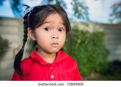 Portrait happy Asian child little girl so cute in the garden