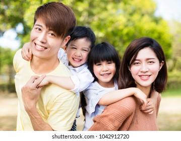 Portrait Of Happy asian Family Inthe park