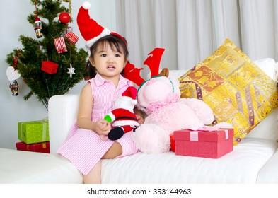 Portrait of happy asian kid in Santa caps on Christmas eve