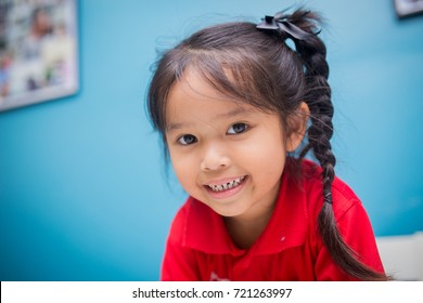 Portrait of happy Asian little girl in living room. wonderful concept