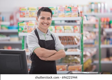 portrait of happy asian male shopkeeper