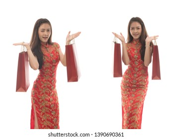 Portrait of happy asian woman wearing chinese dress hold Red shopping bag  isolated on white background, woman in qipao smile in chinese new year concept. Free from copy space.