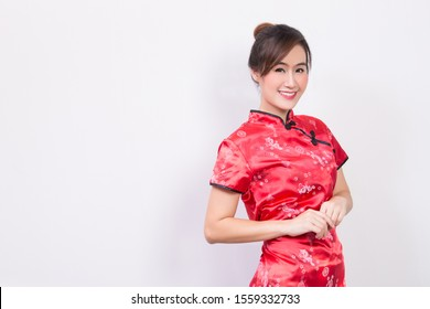 Portrait of happy Asian woman wearing Chinese dress perfect makeup,natural skin isolated on white background with copy space happiness and smiling on face Chinese New Year 2020 holiday concept.