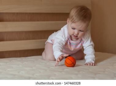 Portrait of a happy baby girl indoors