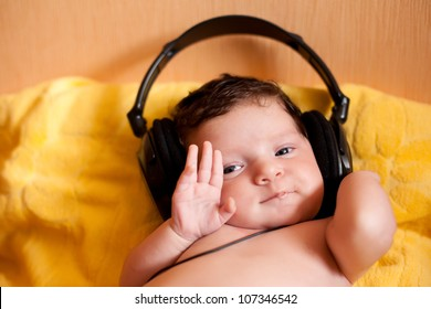 Portrait of happy baby with headphones