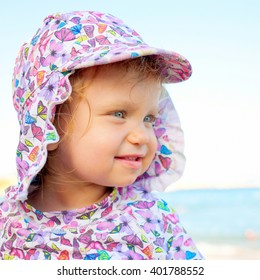 Portrait of happy baby on the beach close-up