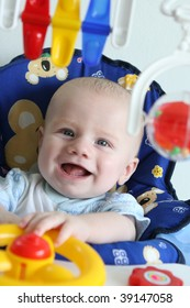 Portrait of a happy baby playing with toys.