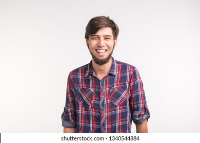 Portrait of happy bearded smiling laughing man on white background