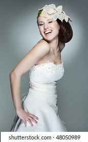 portrait of happy beautiful bride against grey background