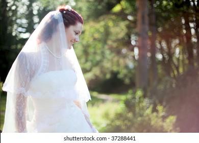 portrait of happy beautiful bride outdoors