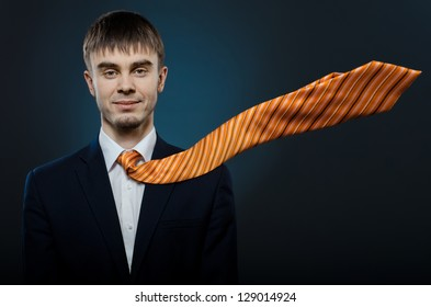 portrait  the  happy beautiful  businessman careerist in costume and orange necktie