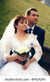 Portrait of happy and beautiful groom and bride embracing