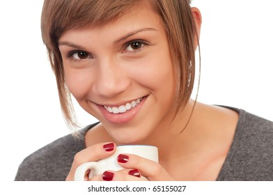 Portrait of a happy beautiful teenage girl holding a cup