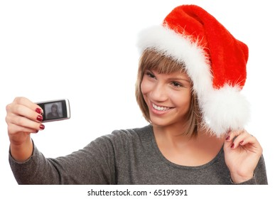 Portrait of a happy beautiful teenage girl wearing Santa hat holding a mobile