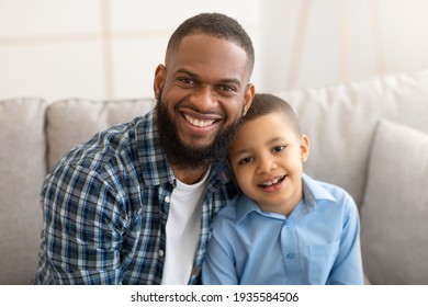 Portrait Of Happy Black Father And Little Son At Home