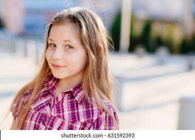 Portrait of happy blond hair ten years old blue eyed girl