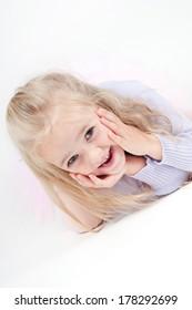 Portrait of happy blond little girl