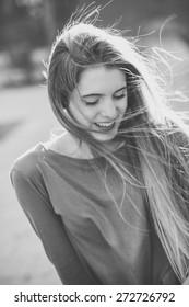 Portrait of happy blonde girl in urban background