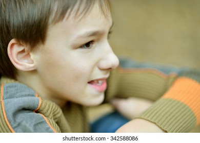 Portrait of happy boy in autumn park