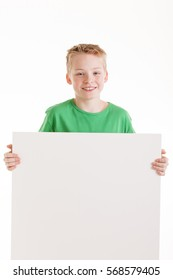 Portrait of happy boy with the empty blank sign isolated on white