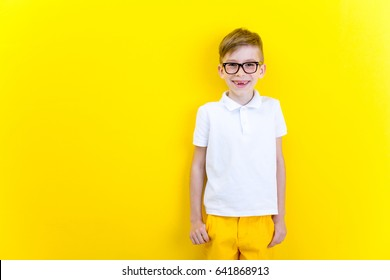 Portrait of a happy boy with glasses on a bright background