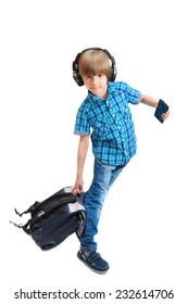 Portrait of happy boy with headphones and backpack