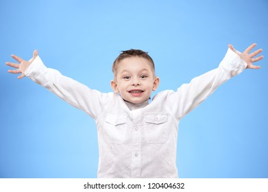 Portrait of a happy boy on a blue background