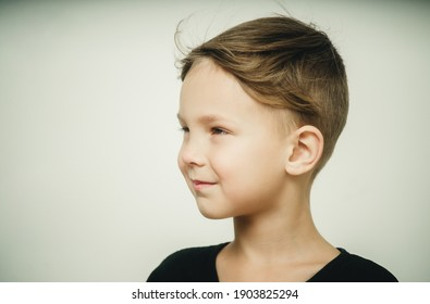 portrait of a happy boy on a white background