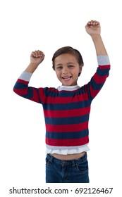 Portrait of happy boy posing against white background