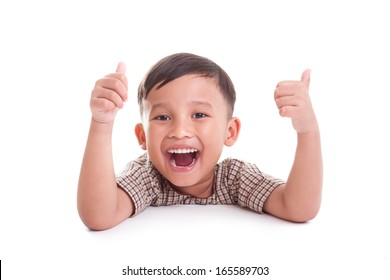 Portrait of happy boy showing thumbs up gesture, on white background