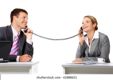 Portrait of happy business partners speaking on the telephone