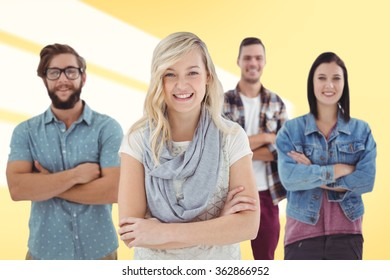 Portrait of happy business professionals with arms crossed against yellow vignette