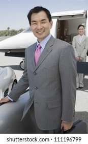 Portrait of happy businessman at an airfield
