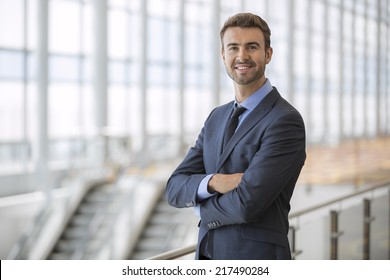 Portrait of happy businessman at an airport terminal