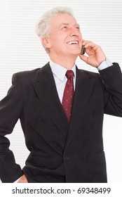 Portrait of a happy businessman on a white